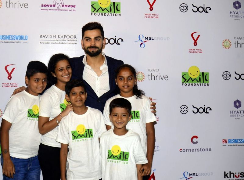 Virat Kohli shares a picture with kids from Smile Foundation.