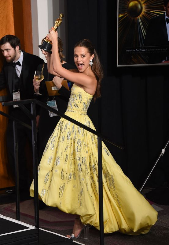 An ecstatic Alicia Vikander poses with her Best Actress in a Supporting Role award  for 'The Danish Girl' in the press room at the Oscars.