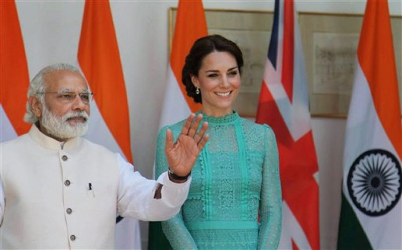 Narendra Modi's pristine white, smartly fitted ensemble, stylishly set off with a baby pink bundi jacket made a bigger statement than Kate's pheeka wishy-washy aqua dress. Her expression was equally listless. There wasn't a touch of saffron in sight. It was so theek hai as to be boring.