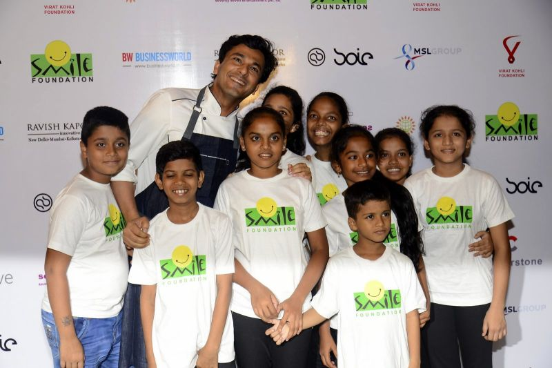Chef Vikas Khanna shares a candid moment with kids from Smile Foundation.