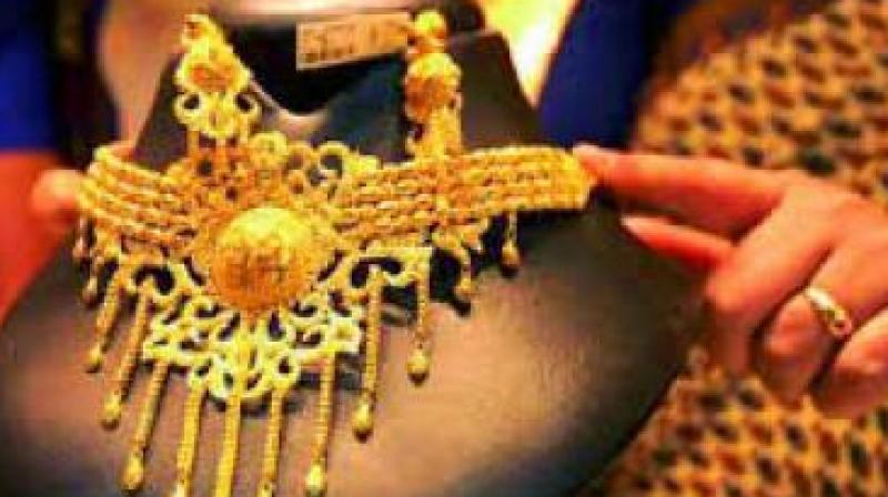 Gold prices in global market retreated as much as 0.40 per cent to USD 1,337.54 an ounce in Singapore today.
