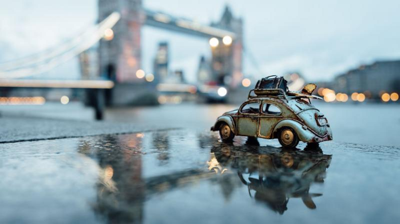 Kim Leuenberger decided to combine her love for travelling and miniature cars by using them as props in her photos. She says that the process of creating such images is a sort of self-therapy for her. (Photo: Instagram/ @kim.ou)