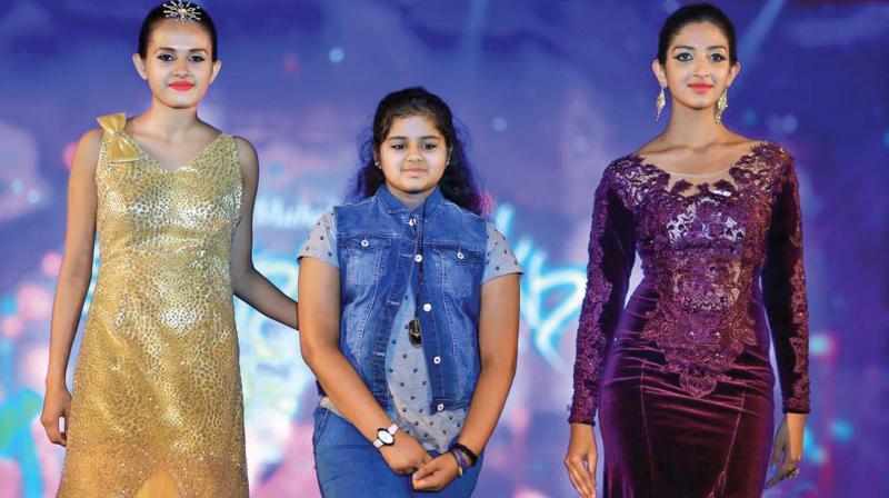 Apeksha with models sporting her design