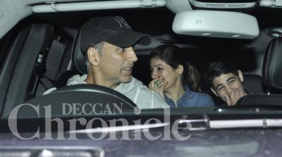 Akshay Kumar took his wife Twinkle, son Aarav and a friend along to catch a movie screening at a multiplex in the city. Photo: Viral Bhayani