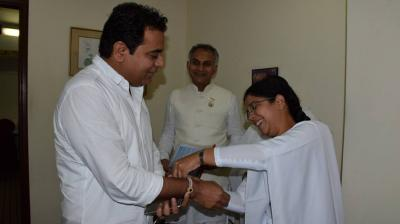 Brahma Kumaris tying Rakhi to Minister Sri KT Rama Rao on the eve of Raksha Bandhan.
