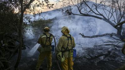 A stubborn wildfire stoked by triple-digit temperatures raged for a sixth day outside Santa Barbara in coastal Southern California as crews worked to keep the blaze some have called a 'sleeping giant' in check.