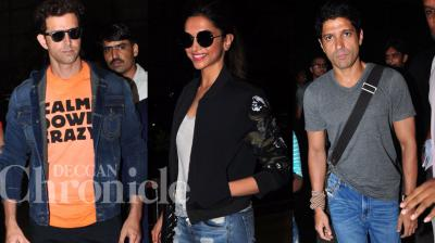 Hrithik Roshan, Deepika Padukone and Farhan Akhtar were spotted at the Mumbai airport on Monday night, catching their Spain bound flight. Photo: Viral Bhayani