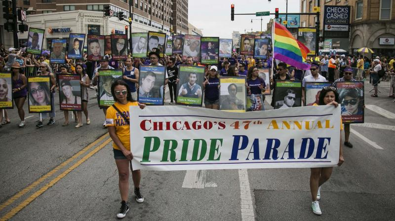 Hundreds of thousands of Americans took to streets from New York to San Francisco to celebrate gay pride, honor those who died in the Orlando massacre and promote tolerance.