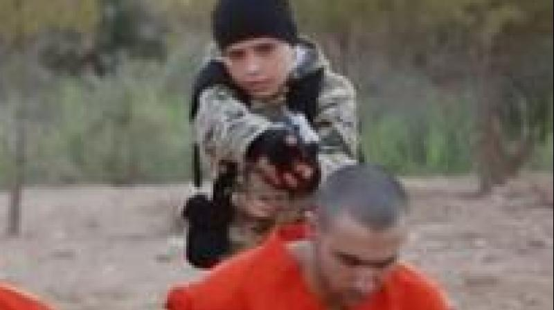 Isis video appears to show children killing captives