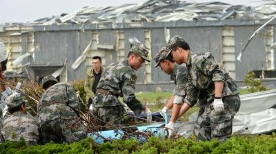 Emergency personnel in China mounted rescue efforts amid scenes of carnage Friday as the toll from hurricane-force winds and a tornado rose to at least 98 dead, with hundreds more injured.