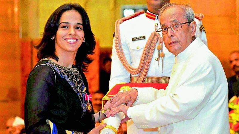 Saina Nehwal, left, receives her Padma Bhushan award in 2016, from President Pranab Mukherjee.