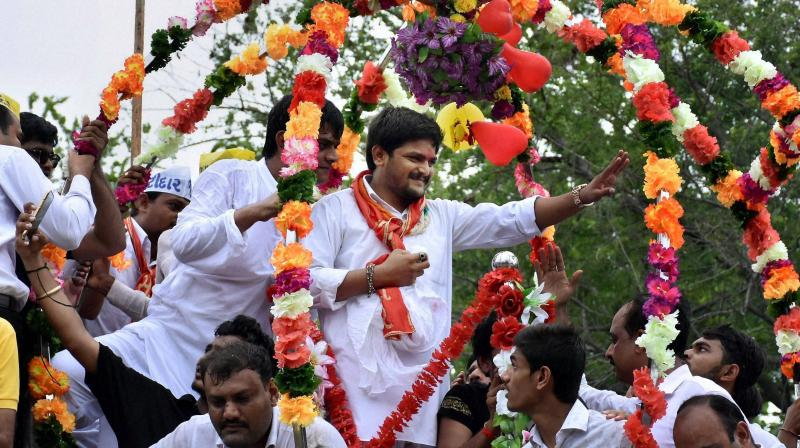 After a stint of 9 months, Hardik Patel walked out of jail with a glee on his face. The 22-year-old Patidar community leader recieved a warm welcome, with a exuberant crowd celebrating his release. (Photo: AP)