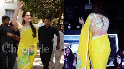 Bollywood fashionista Sonam Kapoor gave the traditional Indian saree a new mordern twist, when she stepped out to promote her film 'Neerja'. Photo: Viral Bhayani