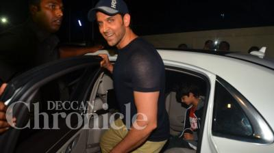 The Roshan boys- Hrithik, Hrehaan and Hridhaan- caught up on some of the latest blockbusters at a multiplex in the city on Saturday night. Photo: Viral Bhayani.
