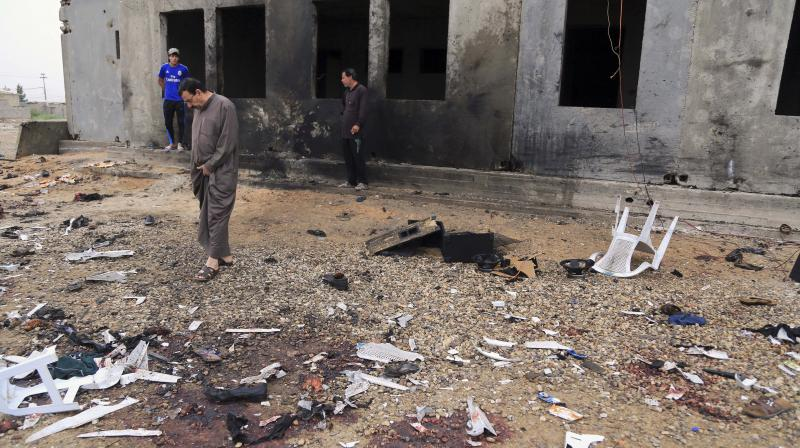 Woman detonates hidden bomb in Iraq market; 31 dead, 35 hurt
