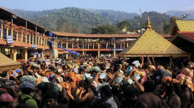 Devotees in queue at the Lord Ayyappa temple in Sabarimala. (Photo: Deccan Chronicle)