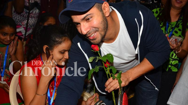 Bollywood actor Varun Dhawan spent his Monday afternoon with 55 visually challenged girls, at an event organised by an NGO in Mumbai. Photo: Viral Bhayani