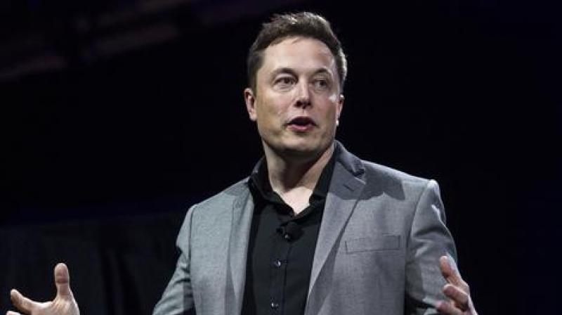 Elon Musk's Tesla Motors said it would collaborate with Japan's Panasonic Corp to manufacture solar cells and modules in New York.