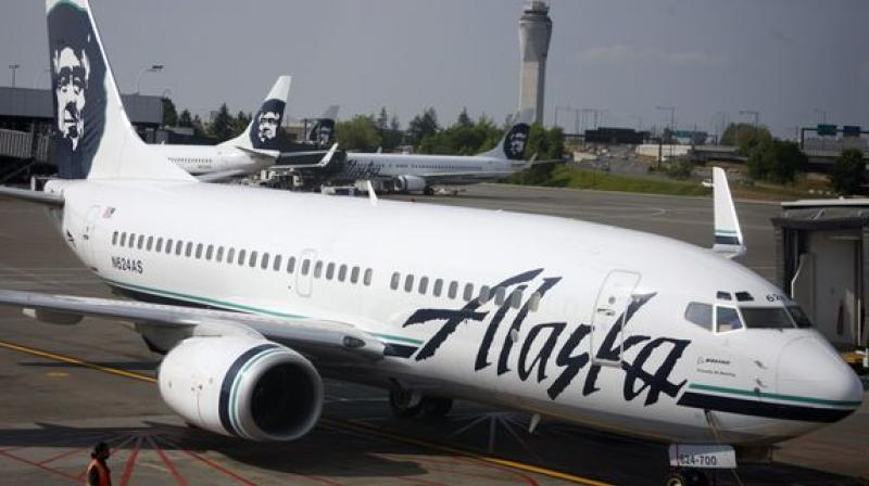 Passenger tried to open door on Seattle-bound flight