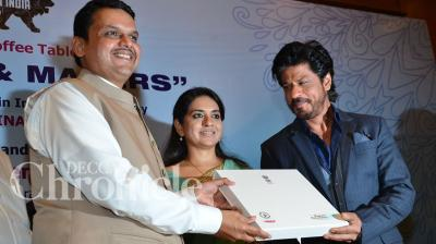 Bollywood star Shah Rukh Khan added glitz and glammour to BJP leader Shaina NC's coffee table book launch in Mumbai on Wednesday. Photo: Viral Bhayani