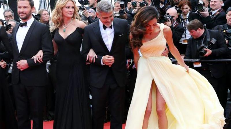 George Clooney S Wife Amal Has An Oops Moment On Cannes