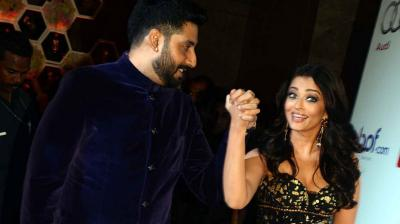 Aishwarya Rai Bachchan was determined not to let her husband Abhishek Bachchan slip through her grip this time around at an award show in the city. Photo: Viral Bhayani
