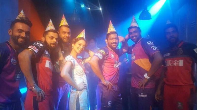 MS Dhoni, Virat Kohli and Kangana Ranaut along with Ajinkya Rahane, R Ashwin, Varun Aaron and Stuart Binny posed for a picture during the IPL promo shoot. (Photo: Twitter)