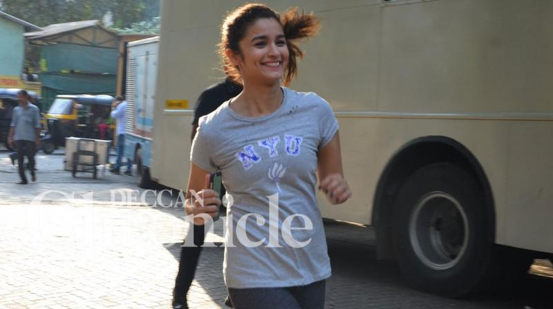 Bollywood star Alia Bhatt looked happy to be back on the film sets to shoot for her next romantic comedy 'Badrinath Ki Dulhania'. Photo: Viral Bhayani