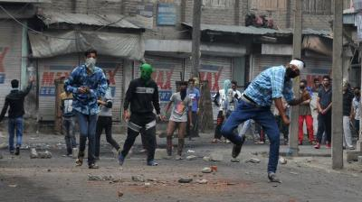 Fresh clashes broke out in South Kashmir on Sunday as unrest continued in the state over the death Burhan Muzaffar Wani, the new-age poster boy of militancy. Police sources said that a mob attacked a policeman and threw his vehicle into nearby river Jhelum. (Photo:  H U Naqash)