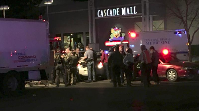 A gunman opened fire in a crowded mall north of Seattle, killing three people and critically wounding another before fleeing from the spot.