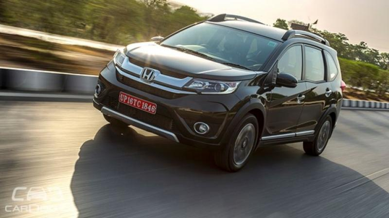 Honda has finally launched the much-awaited all-new BR-V at a starting price of Rs 8.75 lakh (ex-showroom, Delhi). With the new product, Honda has marked its entry in the highly competitive compact SUV segment. The BR-V is based on the same platform as the Brio hatchback, Amaze sedan and the Mobilio MPV. The crossover SUV will face direct competition from the Hyundai Creta, Renault Duster, Mahindra Scorpio and the likes. (Photo: CarDekho.com)