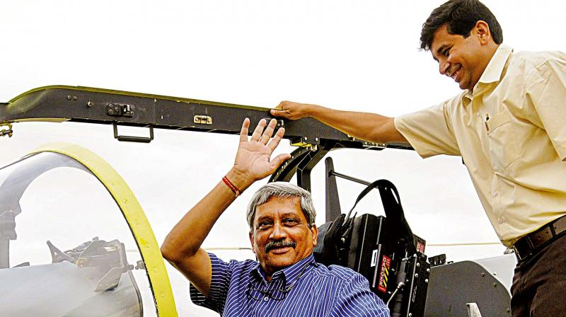 Defence Minister Manohar Parrikar during a flying display of Hindustan Turboprop Trainer (HTT-40) at HAL Airport in Bengaluru on Friday. (Photo: Shashidhar B)
