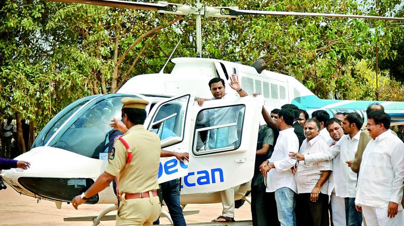 IT minister K.T. Rama Rao entering the helicopter to enjoy the ride.(Photo: DC)