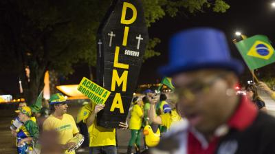 A pro-impeachment demonstrator holds a sign that reads in Portuguese