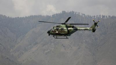 An Indian army helicopter flies over the army base which was attacked by militants in Uri, Jammu and Kashmir. (Photo: AP)