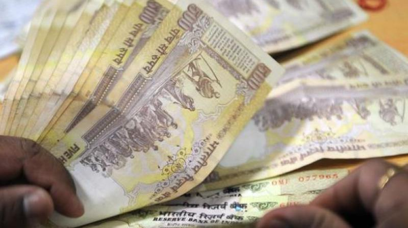 Rupee rises 26 paise to 67.68 per dollar on firm Asian cues