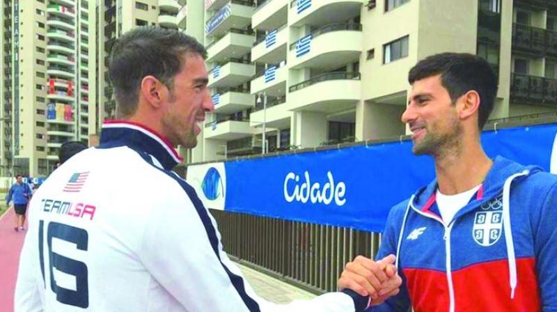 Michael Phelps and Novak Djokovic at the Games Village in Rio de Jeneiro on Thursday.