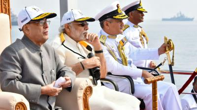 President Pranab Mukherjee along with Prime Minister, Narendra Modi and Commander-in-Chief of Eastern Naval Command, Vice Admiral Satish Soni inspect the fleet of Indian and foreign Naval Ships onboard the Presidential Yacht of IFR-16, INS Sumitra during International Fleet Review in Visakhapatnam on Saturday. (Photo: Murali Krishna)