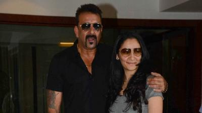 Sanjay Dutt greets the media on his 57th birthday.