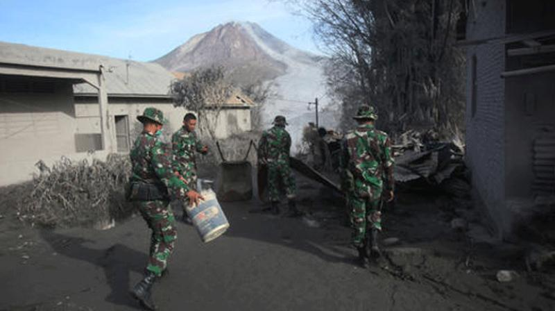 Indonesian rescuers are searching for survivors in scorched villages and devastated farmlands after a volcano erupted in clouds of searing ash and gas, killing seven and leaving others fighting life-threatening burns.