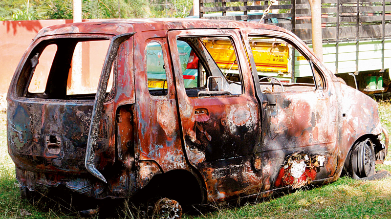 The torched Wagon-R in which the Tanzanian girl was travelling. (Photo: DC)