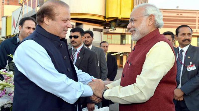 Prime Minister Narendra Modi with his Pakistani counterpart Nawaz Sharif in Lahore. (Photo :PTI)