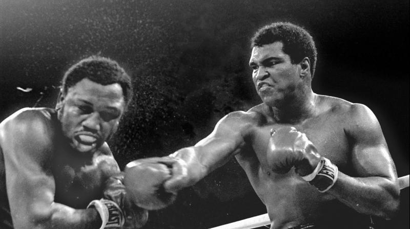 Muhammad Ali taunted opponents with razor-sharp rhymes, comical one-liners and the type of boxing braggadocio that both endeared him to and angered the masses. Ali was a loudmouth threat to the establishment. He could make heavyweight rivals Joe Frazier, Sonny Liston and George Foreman feel like unwitting participants at their own roast. He was king of the world and a clown prince, who fought for both championships and his rights as a conscientious objector. (Photo: AP)
