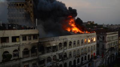 A massive fire broke out in a building near Regal Cinema in South Mumbai's Colaba area on Thursday after noon. (Photo: Shripad Naik)