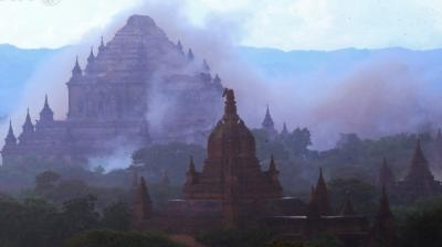 Officials picked through the wreckage of toppled spires and crumbling temple walls in Myanmar's ancient capital Bagan after a powerful earthquake rattled the top tourist destination, leaving three dead.