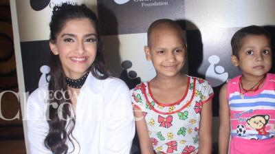 Sonam Kapoor was spotted interacting with children at an event for Cuddles Foundation, an NGO working for children affected with cancer. (Pic: Viral Bhayani)