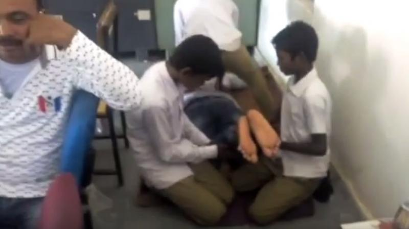 Chhattisgarh school teacher caught on camera getting body massage from students