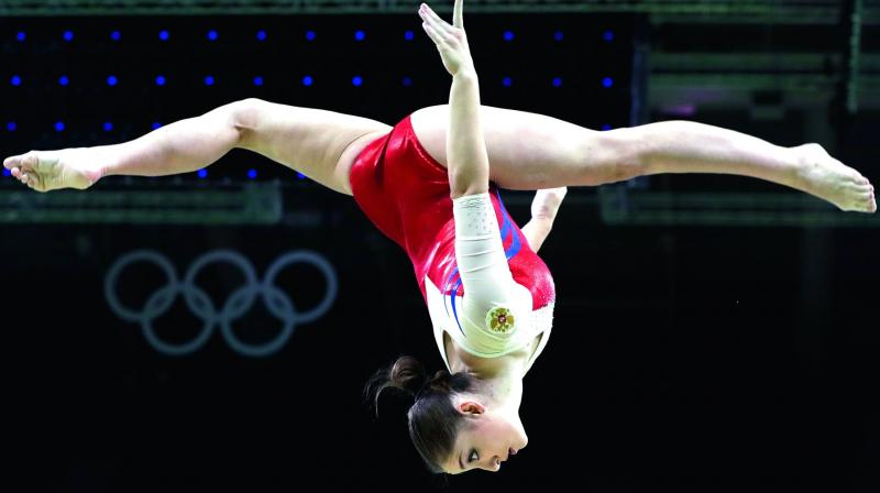 Olympics: U.S. gymnasts wobble way to fifth place