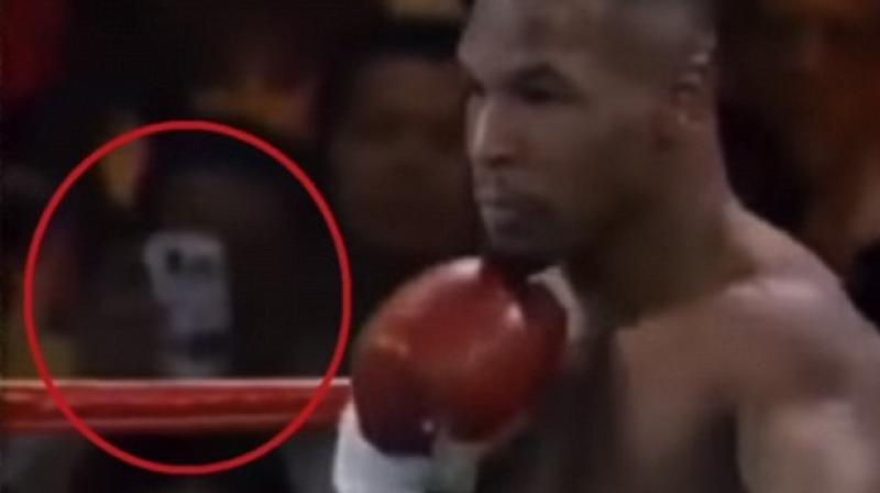 Eerie Time Traveler Caught In Mike Tyson Photo!