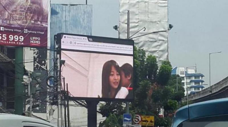 Indonesia arrests man for broadcasting porn on billboard